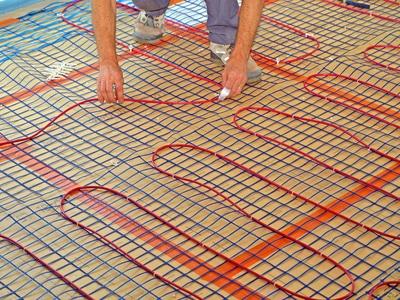 Travaux de chauffage par le sol